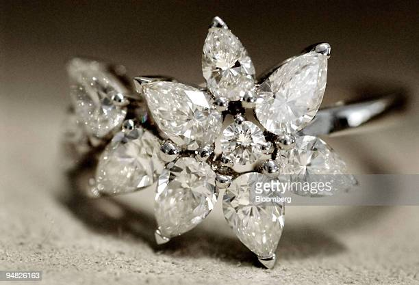 This De Beers 'Cocktail Fizz Ring' consists of one round diamond along with several pear shaped diamonds and is sold for $11 in Los Angeles...