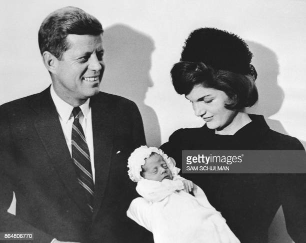 This December 10 file photo shows John F Kennedy and his wife Jacqueline holding their son John during the christening ceremony at the chapel of...