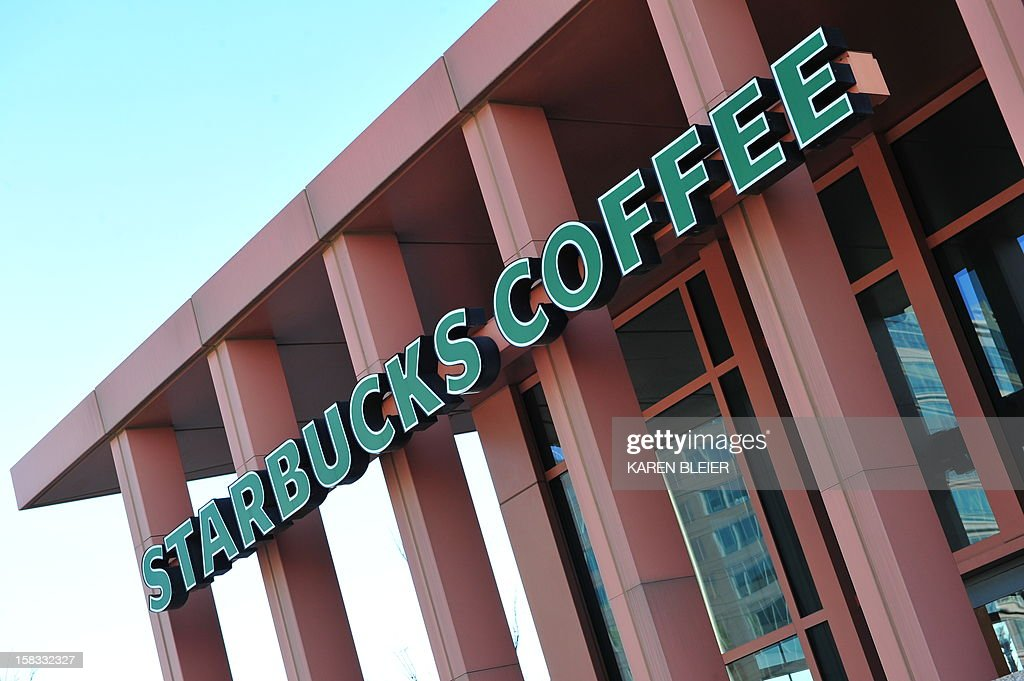 This December 13, 2012 photo shows a sign for a Starbucks coffee house in Washington, DC. AFP PHOTO/Karen BLEIER