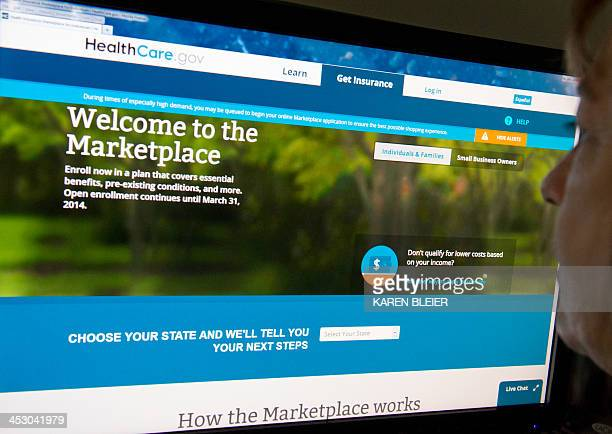 This December 2 2013 photo shows a woman reading the HealthCaregov insurance marketplace internet site in Washington DC The troubleshooter appointed...
