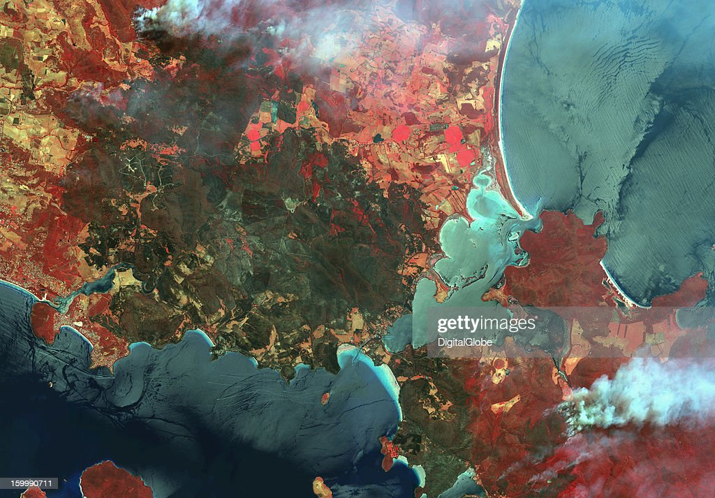 This false-color image acquired January 6, 2013, provides an overview of the active fires and burned areas 35 kilometers east of Hobart in southeast Tasmania. Captured two days after the fires initially spread, the image shows large active fires in areas near Forcett and Murdunna. Burned areas are highlighted in a dark green color; healthy vegetation is represented in red.