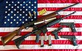 This February 4 2013 photo illustration in Manassas Virginia shows a Remington 20gauge semiautomatic shotgun a Colt AR15 semiautomatic rifle a Colt...