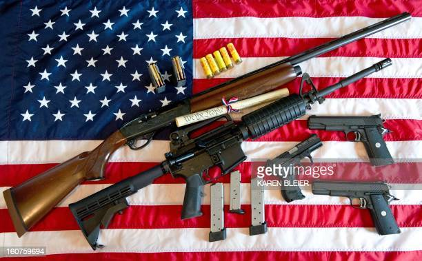 This February 4 2013 photo illustration in Manassas Virginia shows a Remington 20gauge semiautomatic shotgun a Colt AR15 semiautomatic rifle a Colt...