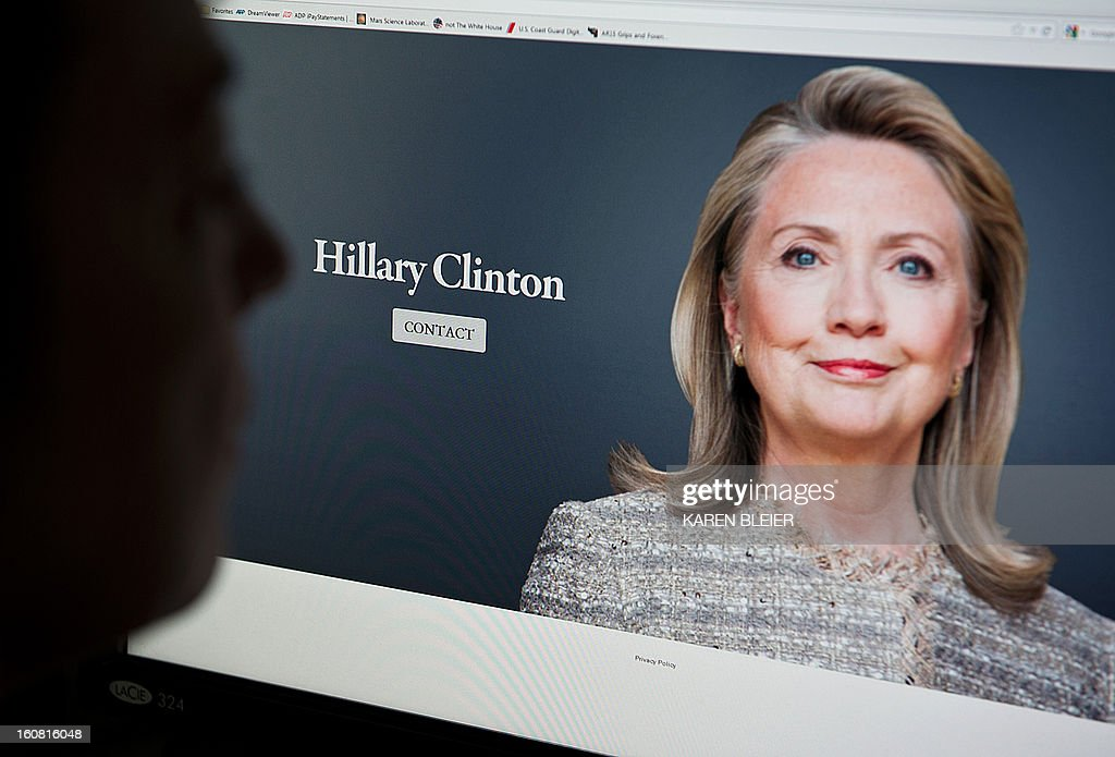 This February 6, 2013 photo illustration shows a woman viewing the new website of Hillary Clinton in Washington, DC. Once again fueling speculation about whether she will run for president in 2016, Hillary Clinton launched a new website even before she officially stepped down as secretary of state. HillaryClintonOffice.com only features a picture of Clinton -- without the black glasses she took to wearing in the last few weeks of her reign at the State Department -- and a contact sheet. According to news reports, the website was registered on Thursday, just 24 hours before Clinton stepped down as America's top diplomat, handing the baton to John Kerry. AFP PHOTO / Karen BLEIER