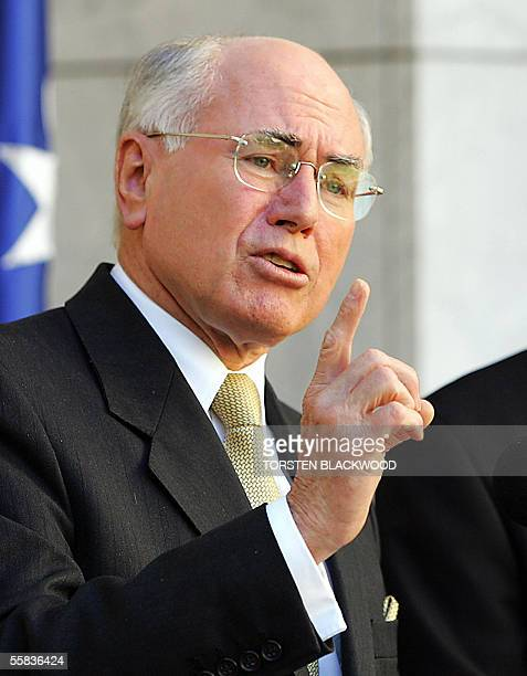 This file photo dated 23 August 2004 shows Australian Prime Minister John Howard gesturing during a speech at Parliament House in Canberra Howard...