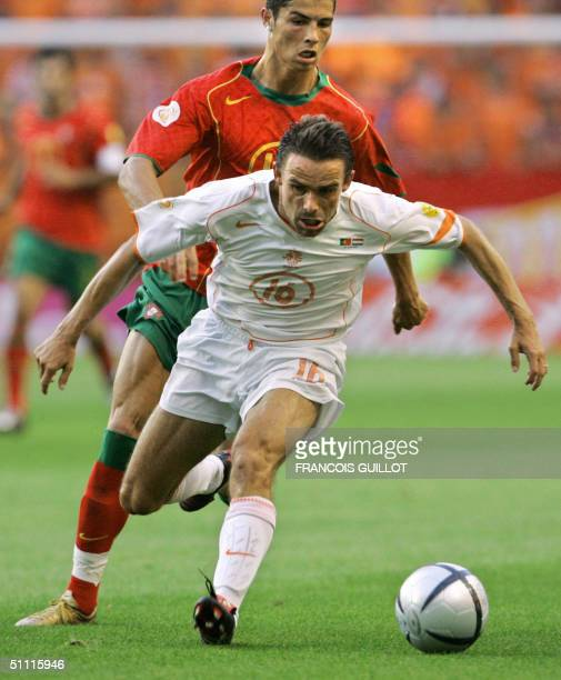 This file photo dated 30 June 2004 shows Dutch forward Marc Overmars with Portuguese forward Cristiano Ronaldo at the Alvalade stadium in Lisbon...