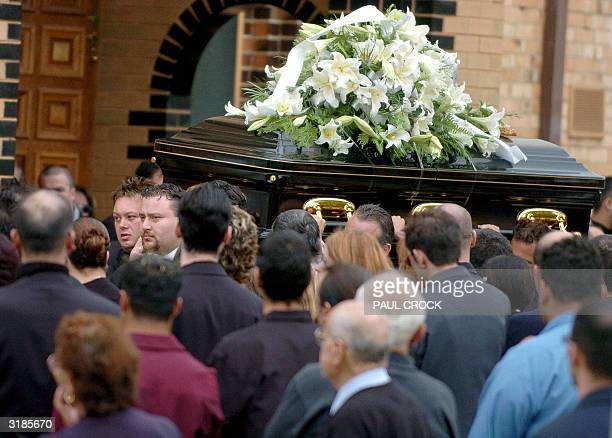 This file photo dated 30 March 2004 shows Australian underworld figure and accused drug trafficer Carl Williams helping carry the casket of his...