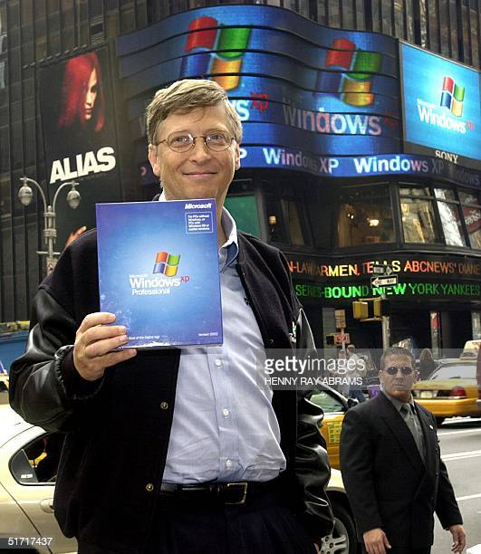 This file photo shows Microsoft Chairman Bill Gates holding up a copy of the new Windows XP operating system while posing for photos in New York's...