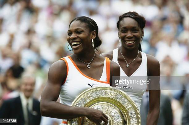 This file photo shows Serena Williams of the USA holding the trophy after her match against sister Venus Williams of the USA in the Womens Singles...