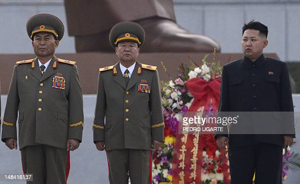 This file photo taken on April 13 2012 shows North Korean leader Kim JongUn attends the unveiling ceremony of two statues of former leaders Kim...