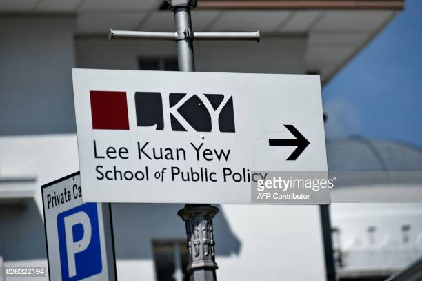 This file photo taken on April 16 2015 shows a sign board pointing towards the Lee Kuan Yew School of Public Policy in Singapore Singapore said on...