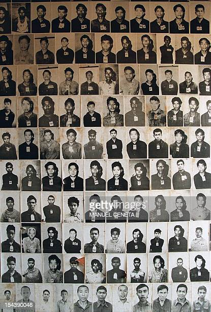 This file photo taken on April 17 1998 shows photographs of the victims of the 'Killing Fields' displayed at the genocide museum set up at Toul Sleng...