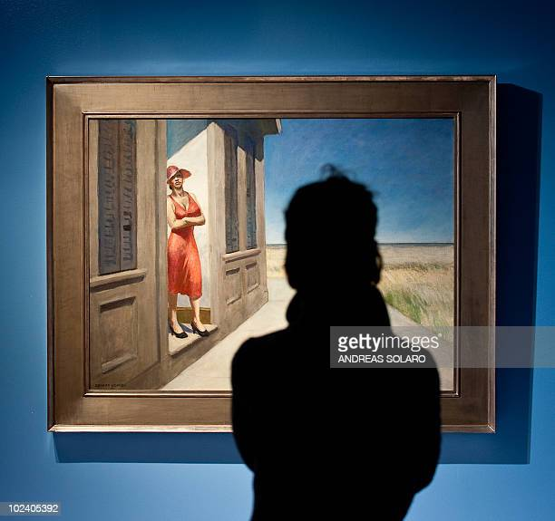 This file photo taken on February 24 2010 of a visitor looking at 'South Carolina Morning' painting by US artist Edward Hopper during the exhibition...