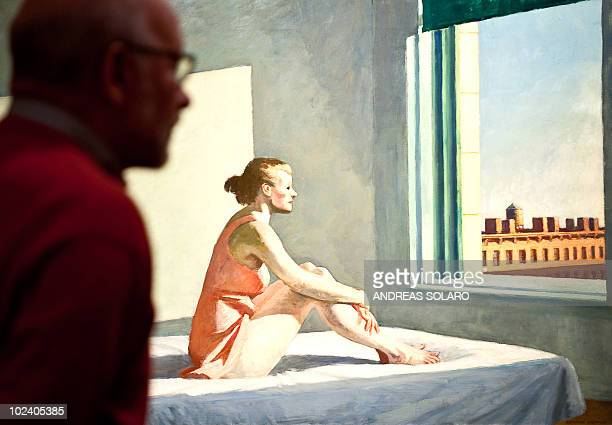 This file photo taken on February 24 2010 of a visitor looking at 'Morning Su' painting by US artist Edward Hopper during the exhibition at the...