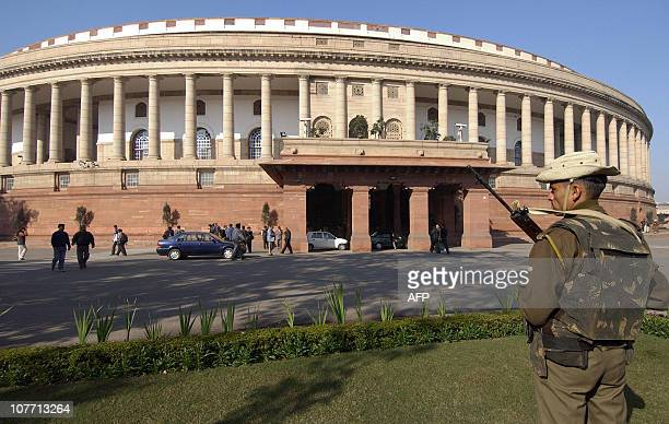 This file photo taken on February 3 2004 shows an Indian paramilitary soldier standing guard in front of the Parliament house in New Delhi On...