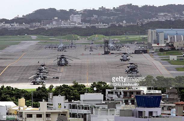 This file photo taken on June 22 2005 shows US helicopters and planes parked at Futenma US Marine Base in Ginowan Okinawa Prefecture The United...