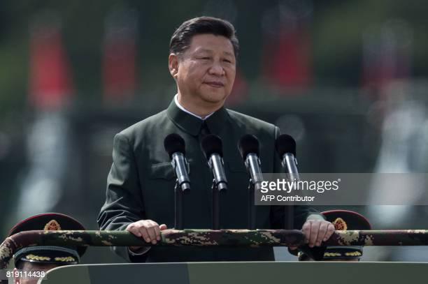 This file photo taken on June 30 2017 shows China's President Xi Jinping inspecting People's Liberation Army soldiers at a barracks in Hong Kong A...