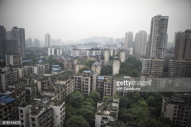 This file photo taken on May 31 2017 shows a general view of buildings and skyscrapers in Chongqing A sudden leadership change in one of China's...