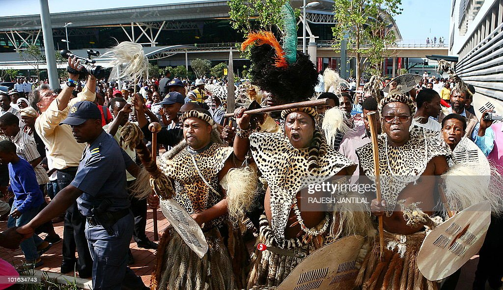 This file photo taken on May 8, 2010 of the Zulu warriors celebrating the official opening of the central terminal building of Durban's new King Shaka International Airport and Dube Trade Port, north of Durban. Zulus are now South Africa's largest ethnic group, at 24 percent of the population, and their history and culture are being turned into a tourist drawcard. Spear-wielding warriors pour over the hilltops to attack a startled red-coat army, in a battlefield re-enactment that hopes to lure World Cup fans away from the stadiums between matches.