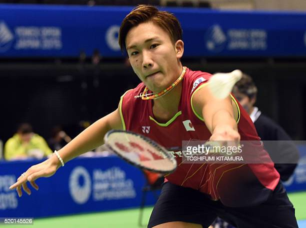 This file photo taken on September 10 2015 shows Japanese badminton player Kento Momota during a men's singles second round match against Tommy...
