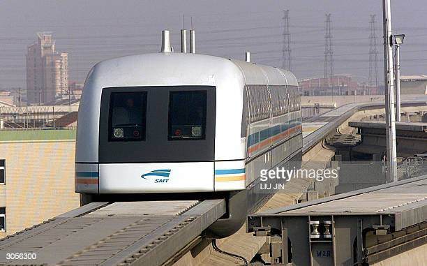 This file photod dated 01 January 2003 shows a magnetic levitation train arriving at the Longyang Road station in Shanghai's Pudong New District The...