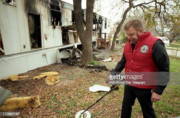 This File Photograph Shows An Investigator Searching For Metal At The Rented Trailer Home Of