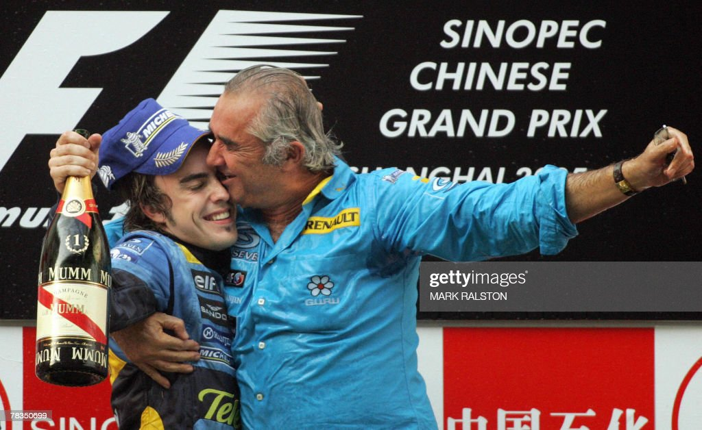 This file picture dated 16 October 2005 shows Spanish formula one driver Fernando Alonso from the Renault team celebrating on the podium with team...