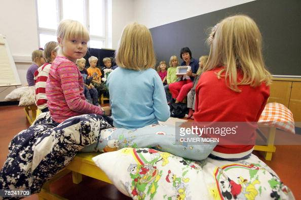 This file picture dated 17 August 2005 shows children listening to their teacher in a primary school in Vaasa on the second day of school in Finland...