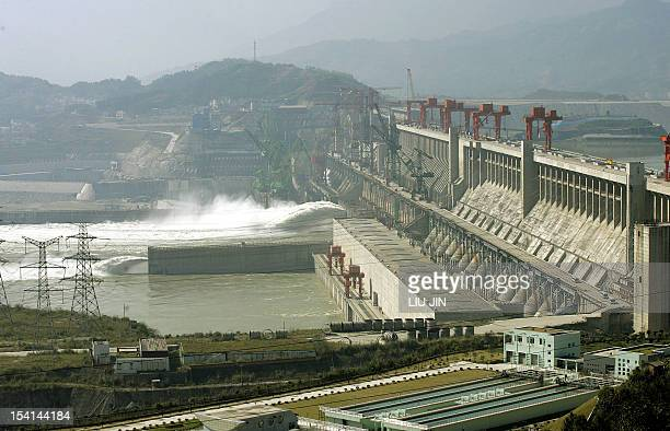 This file picture dated 29 October 2005 shows China's Three Gorges dam crossing over the Yangtze River in Yichang in the central province of Hubei...