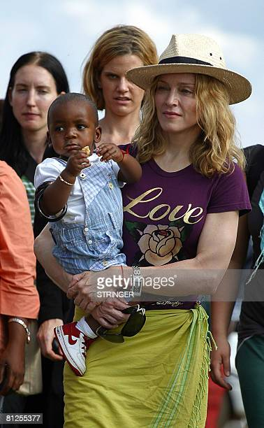 This file picture dated April 19 2007 shows billionaire pop star Madonna posing with her Malawian son David Banda in Mphandula Madonna won approval...