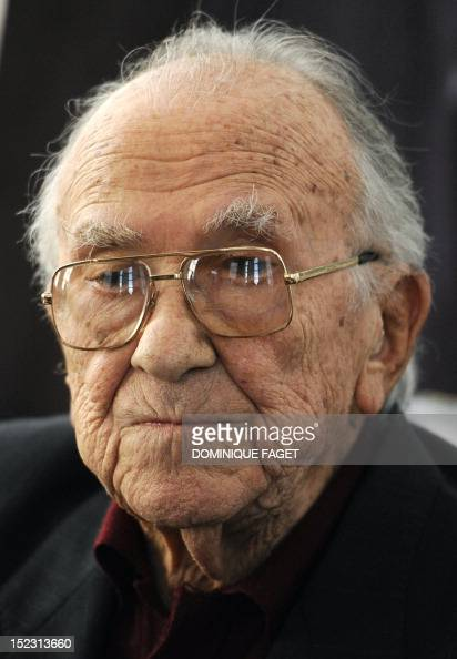 This file picture dated April 6 2010 shows Spanish politician and former SecretaryGeneral of the Spanish Communist Party Santiago Carrillo looking on...