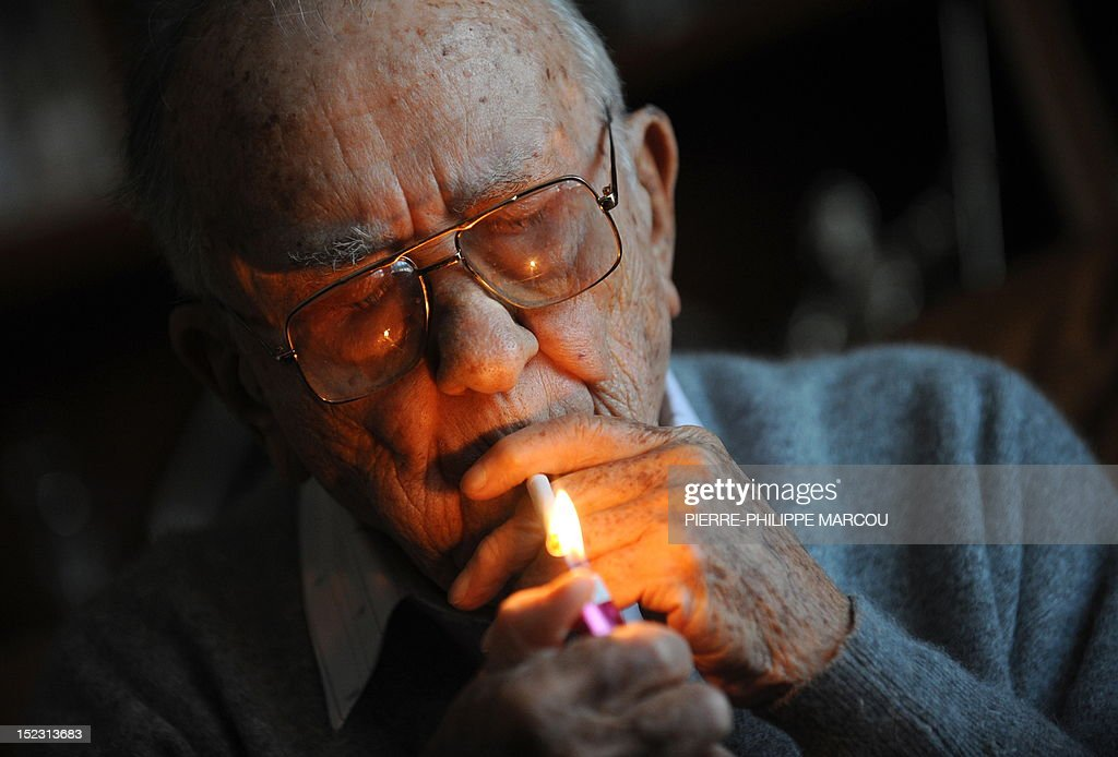 This file picture dated November 20 2008 shows Spanish politician and former SecretaryGeneral of the Spanish Communist Party Santiago Carrillo giving...