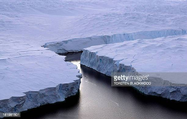 This file picture shows an enormous iceberg breaking off the Knox Coast in the Australian Antarctic Territory on January 11 2008 A UN panel said on...