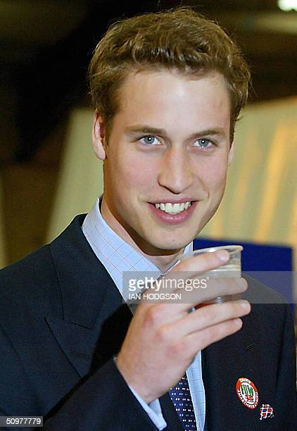 This file picture shows Britain's Prince William having a drink of beer on a visit to the Anglesey Agricultural centre in Anglesey Wales 19 June 2003...