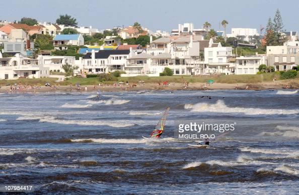 This file picture shows tourists windsurfing in La Barra near Punta del Este Maldonado 140 km east of Montevideo on January 8 2010 Punta del Este and...