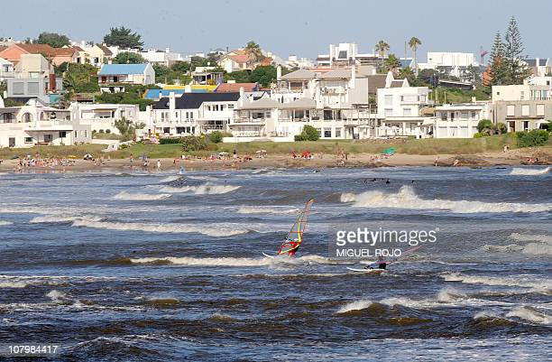 This file picture shows tourists windsurfing in La Barra near Punta del Este Maldonado 140 km east of Montevideo on January 8 2010 Punta del Este and...