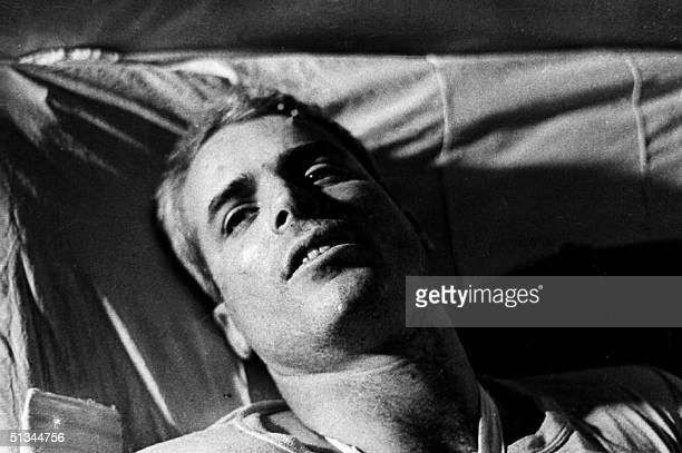 This file picture taken in 1967 shows US Navy Airforce Major John McCain lying on a bed in a Hanoi hospital as he was being given medical care for...