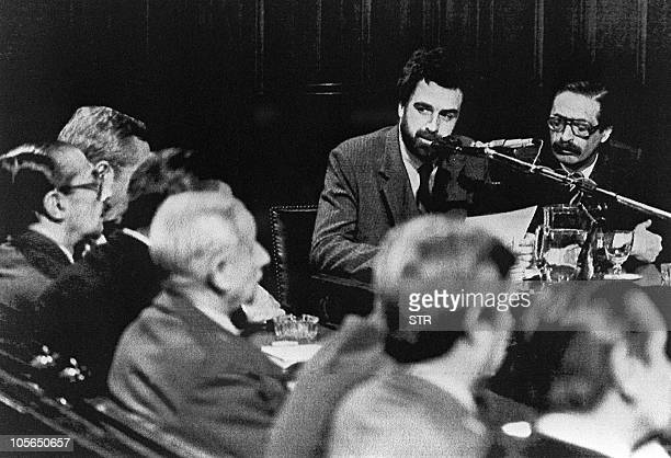This file picture taken in Buenos Aires 13 September 1985 shows Argentine deputy Attorney Luis Moreno Ocampo and attorney Julio Cesar Strassra...