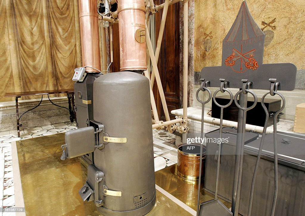 This file picture taken on April 16, 2005 shows the stove (L), where the ballots to elect a new pontiff will be burned in the Sistine Chapel at the Vatican. The Catholic Church faced a tricky transition on February 12, 2013 as it prepared to elect a new pope, with many faithful still reeling from the shock resignation of Pope Benedict XVI.