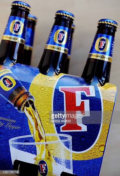 This file picture taken on August 25 2009 shows a sixpack of Fosters lager bottles in Sydney Britishbased brewer SABMiller on Wednesday September 21...