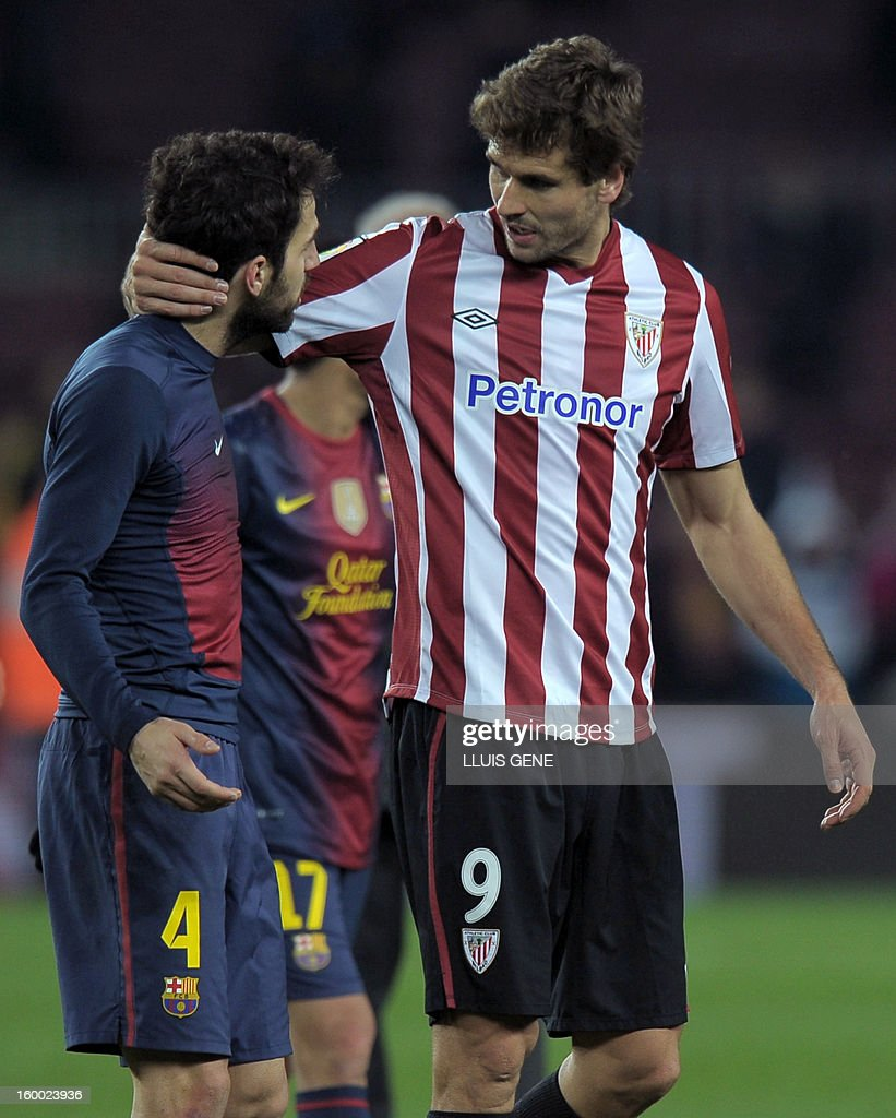This file picture taken on December 1, 2012 shows Athletic Bilbao's forward Fernando Llorente (R) talking with Barcelona's midfielder Cesc Fabregas at the end of the Spanish league football match FC Barcelona vs Athletic Bilbao at the Camp Nou stadium in Barcelona. Italian champions Juventus have confirmed on January 24, 2013 that the signing of Spanish international striker Fernando Llorente, who will join the club after his contract with Athletic Bilbao ends this summer.