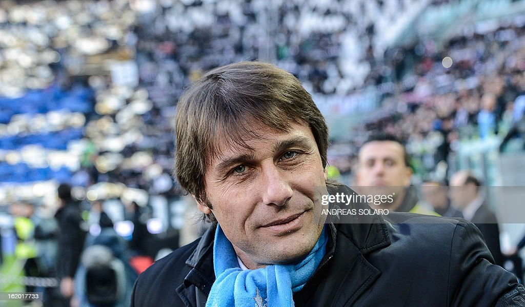 This file picture taken on December 16, 2012 at Turin's Juventus stadium shows Juventus' coach Antonio Conte pictured before the start of the Italian Serie A football match Juventus vs Atalanta. Conte was awarded on February 18, 2013 Italian coach of the year. AFP PHOTO / FILES / ANDREAS SOLARO