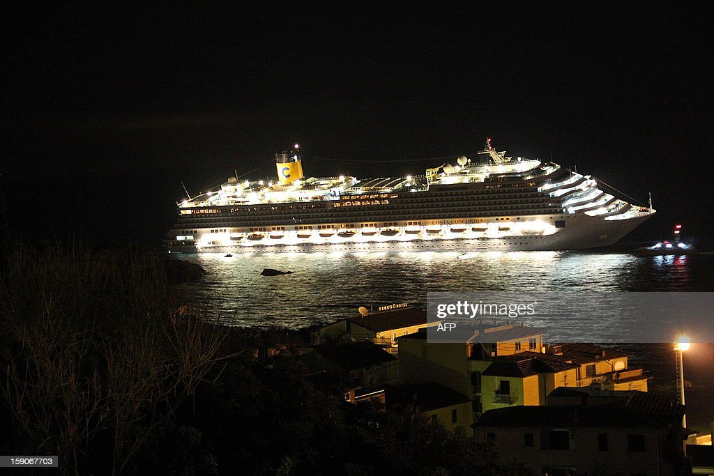 This file picture taken on early on January 14, 2012 of the Costa Concordia after the cruise ship with more than 4,000 people on board ran aground and keeled over off the Isola del Giglio, and Italian island, hours before. Almost a year ago, on January 13, 2012, the giant Italian cruise ship Costa Concordia ran aground near a Tuscan island and pitched leaving 32 people dead.