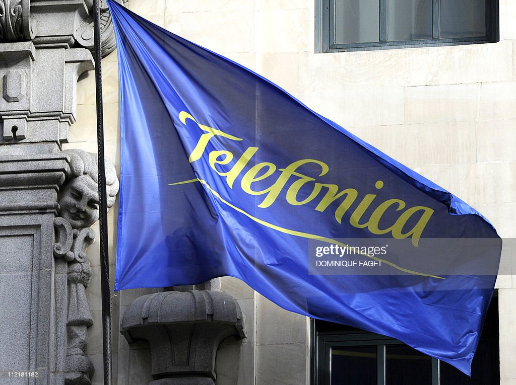 This file picture taken on February 5, 2010 shows the logo of the Spanish Telecom Company Telefonica pictured on a flag at the building housing the headquarters of the company in Madrid. Spanish telecoms giant Telefonica said on April 14, 2011 it plans to cut its workforce in Spain by about 20 percent, or some 6,000 people, over the next three years as a cost-cutting measure. AFP PHOTO/DOMINIQUE FAGET