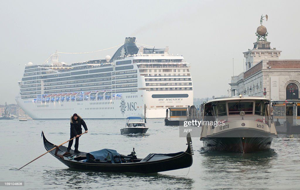 This file picture taken on January 23, 2011 shows the MSC Magnifica cruise liner ship passing near St Mark's square in Venice's basin. A year after the shipwreck of the Costa Concordia luxury liner off Giglio island, cruise ships are still sailing close to the coast in Venice.