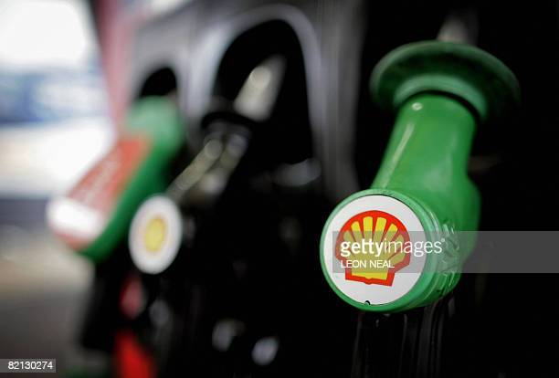 This file picture taken on January 31 2008 in London shows petrol pumps at a Shell garage AngloDutch energy giant Royal Dutch Shell said Thursday...