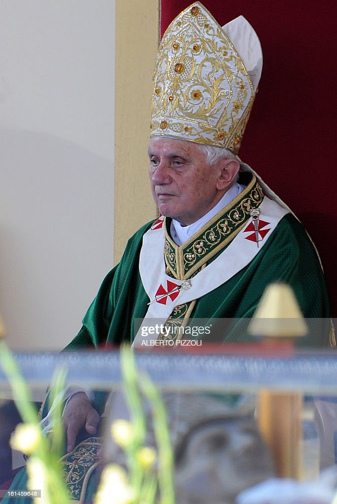This file picture taken on July 4, 2010 shows Pope Benedict XVI looking on as he seats near the relics of one of his predecessors, St Celestine V, during a Holy mass on the occasion of the 800th anniversary of Celestine V's birth in central Garibaldi square in Sulmona. Pope Benedict XVI announced on February 11, 2013 his resignation, while the last pope to have abdicated the papacy is Celestin V in 1294. AFP PHOTO / FILES / ALBERTO PIZZOLI