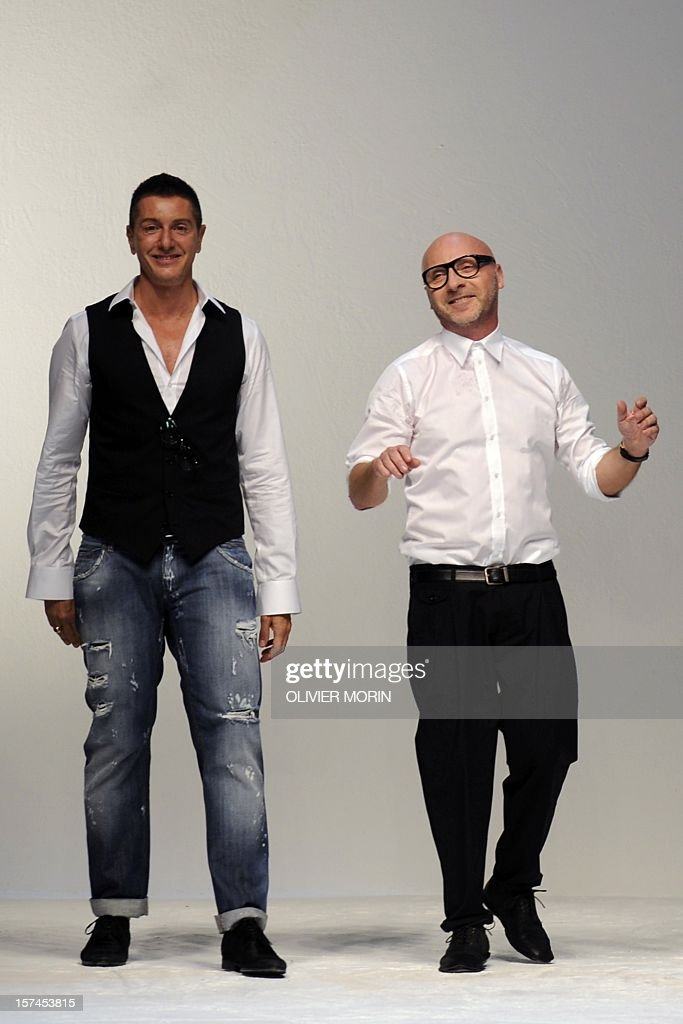 This file picture taken on June 18, 2011 during the Men's fashion week in Milan shows designers Stefano Gabbana (L) and Domenico Dolce acknowledging the audience at the end of the Dolce & Gabbana Spring-Summer 2012 Menswear collection. The trial of Domenico Dolce and Stefano Gabbana, accused of fraud of around one billion euros ($1.4 billion) as part of an enquiry into reports the company had failed to declare 840 million euros in revenues opened on December 3, 2012. AFP PHOTO / FILES / OLIVIER MORIN