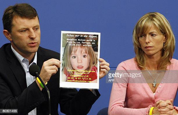This file picture taken on June 6 2007 shows Kate and Gerry McCann parents of missing 4yearold British girl Madeleine McCann holding up a picture of...
