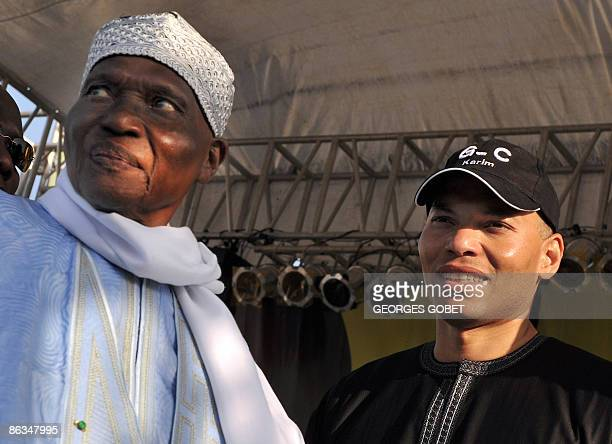 FILES This file picture taken on March 20 2009 shows Senegalese veteran President Abdoulaye Wade flanked by his son Karim Wade during a meeting in...